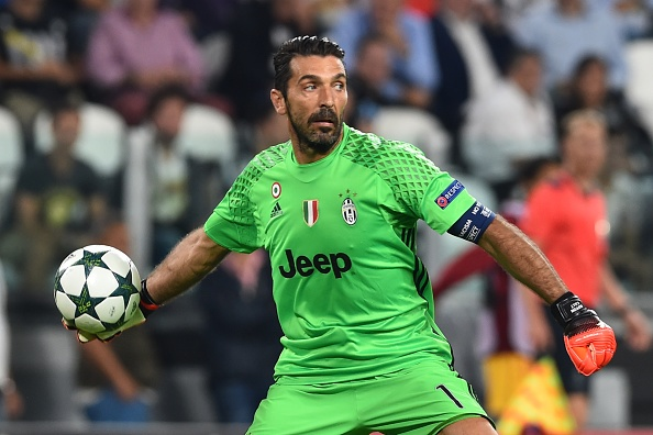 Gigi Buffon redistributes the ball during Juve's match against Sevilla in the UCL. (Photo by Giuseppe Cacace/AFP/Getty Images)