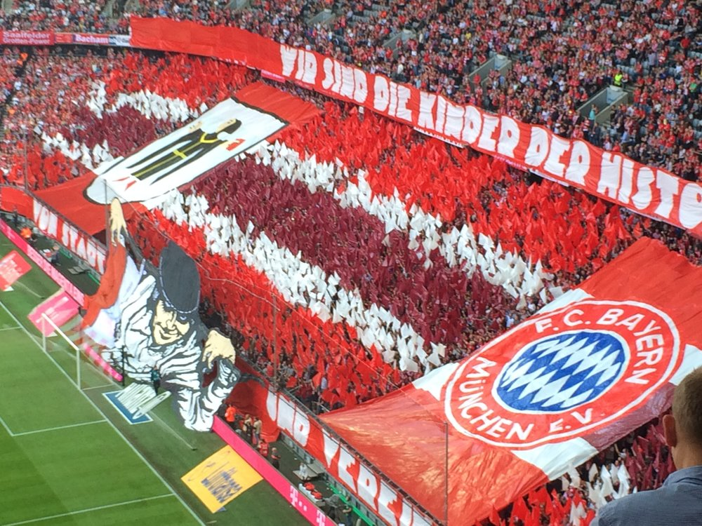 Bayern fans unfurl their banners behind Manuel Neuer's goal just before kickoff.