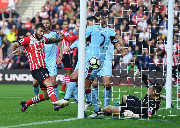 Charlie Austin bundles in the first goal for the Saints. (Photo by Mike Hewitt/Getty Images)
