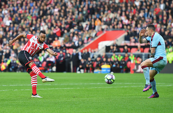 Nathan Redmond shooting past Dean Marney to score the Saints' second. (Photo by Mike Hewitt/Getty Images)