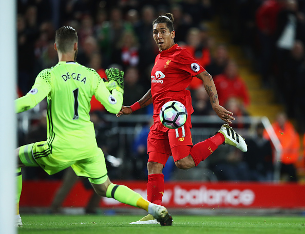 Firmino almost breaks through, but he's ruled offside. (Photo by Clive Brunskill/Getty Images)