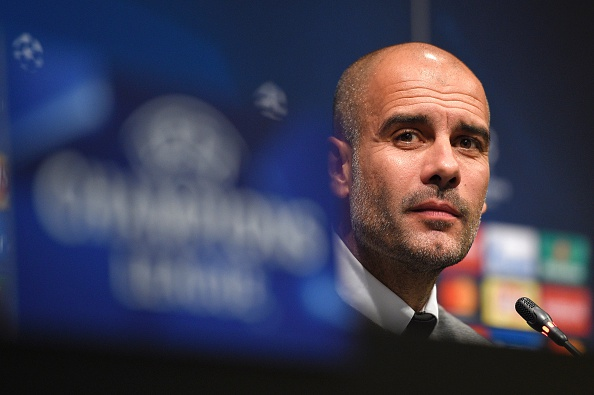 How will Guardiola set up his team in this game? (Photo by LLUIS GENE/AFP/Getty Images)