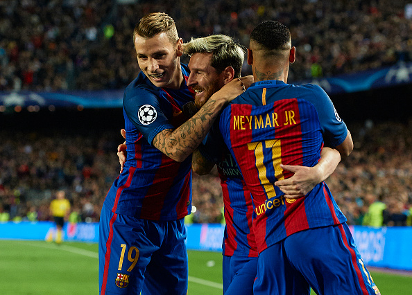 Messi celebrates his first goal with teammates. (Photo by Manuel Queimadelos Alonso/Getty Images)