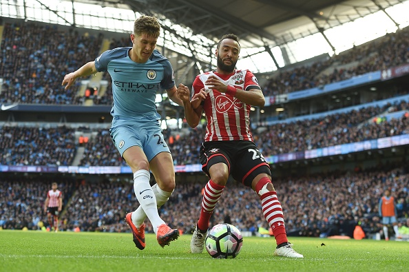 Stones gave away possession which eventually led to a goal in City's last game vs. Southampton. (Photo by Paul Ellis/AFP/Getty Images)