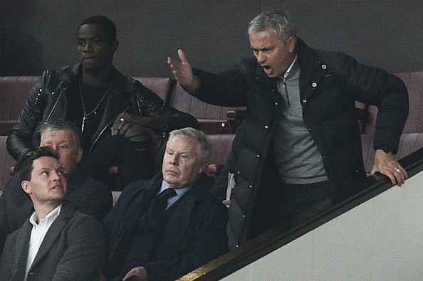 See if you can spot Mourinho. (Photo by OLI SCARFF/AFP/Getty Images)