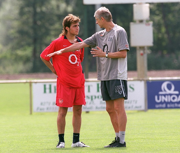 A young Fabregas receiving instructions from Monsieur Wenger. (Photo by Stuart MacFarlane/Arsenal FC via Getty Images)