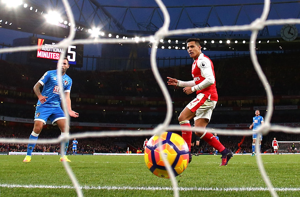 Sanchez scores his side's third goal, ending the fightback that Bournemouth had started. (Photo by Clive Rose/Getty Images)