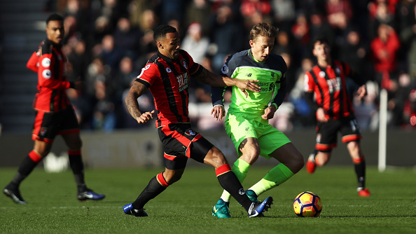 Lucas threatens to take the ball away from Callum Wilson. (Photo by Bryn Lennon/Getty Images)