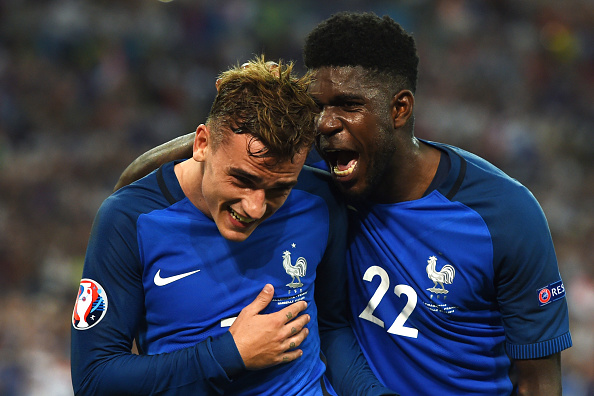 Umtiti (R) is one of many who've made their name in Ligue 1 before moving elsewhere.  (Photo by PATRIK STOLLARZ/AFP/Getty Images)
