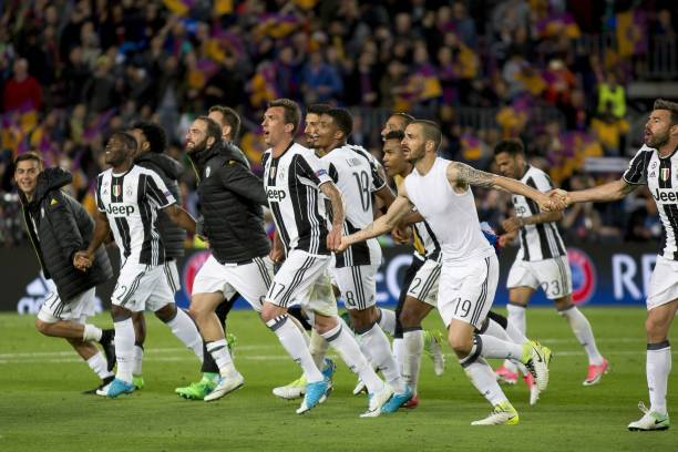 Juve players celebrate their victory against Barca. (Photo via Getty Images)