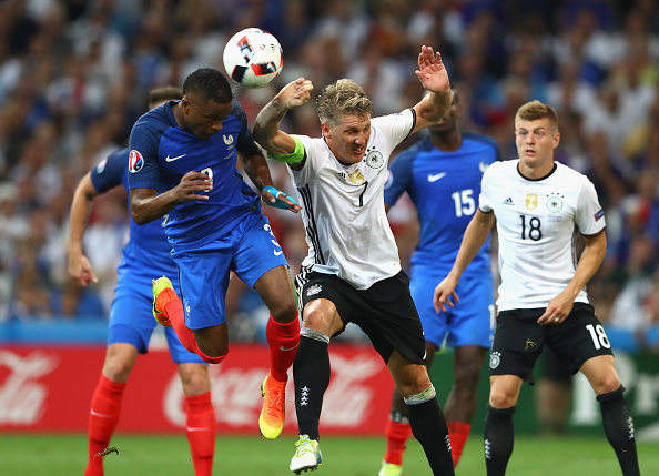 Schweinsteiger decided to contest against his teammate Boateng's handball against Italy. (Photo via  Getty Images )