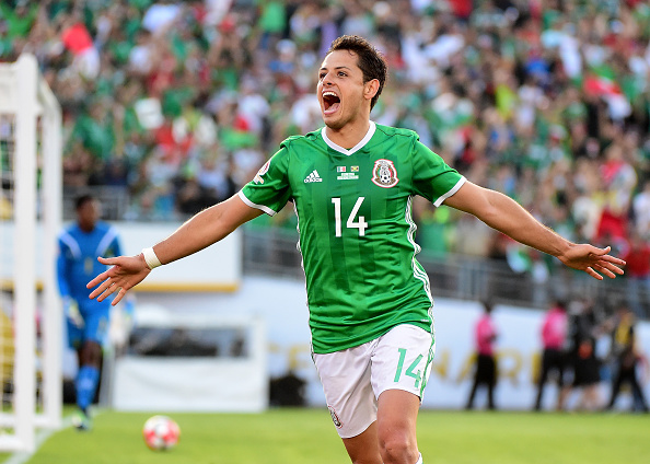 PASADENA, CA - JUNE 09: Chicharito #14 of Mexico celebrates after his goal in front of Andre Blake #1 of Jamaica to take a 1-0 lead during Copa America Centenario at the Rose Bowl on June 9, 2016 in Pasadena, California. (Photo by Harry How/Getty Images)