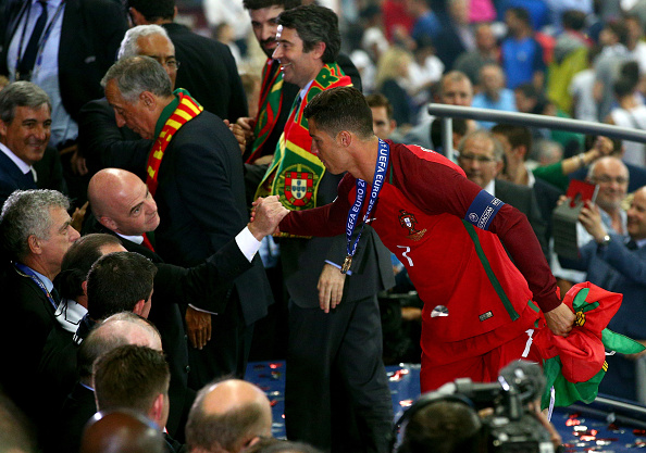 Ronaldo is congratulated by Gianni Infantino, the FIFA President, after Portugal's triumph in UEFA Euro 2016.  (Photo by Alex Livesey/Getty Images)