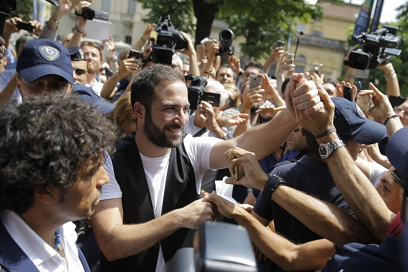 Gonzalo Higuain arrives at Juventus following his move. The  Bianconeri fans are obviously overjoyed. (Photo by Marco Bertorello/AFP/Getty Images)