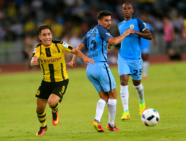 Emre Mor gets the better of Jesus Navas during Man City's friendly against Dortmund in China. (Photo by VCG/Getty Images)