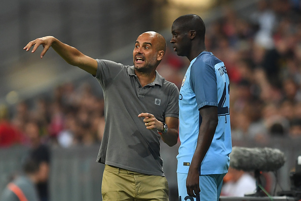 Yaya getting instructions from Pep before making a substitute appearance against Bayern Munich. In the ICC, of course. (Photo by Lennart Preiss/Bongarts/Getty Images)