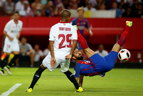 Turan's miscued attempt at a bicycle kick during Barca's match against Sevilla. (Photo by Fernando Ruso/Andalou Agency/Getty Images)