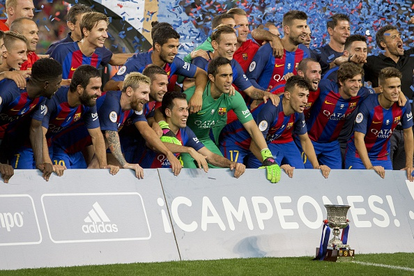 Barcelona players celebrate their Spanish Super Cup victory against Sevilla. (Photo by Albert Llop/Anadolu Agency/Getty Images)