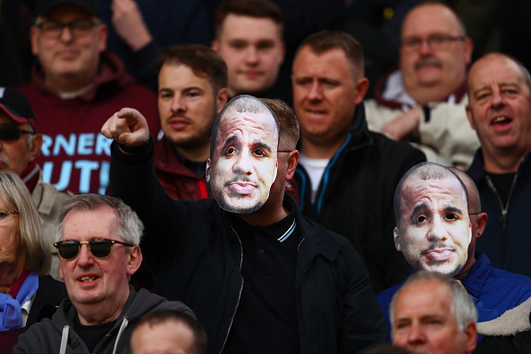 Aston Villa fans mock their player's ridiculous inability to return to full fitness. (Photo by Clive Rose/Getty Images)