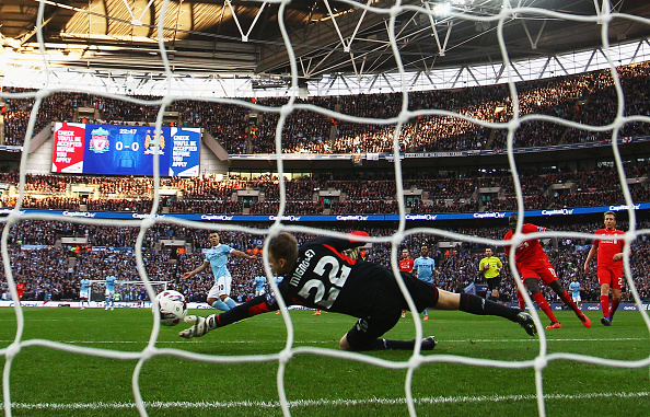 LONDON, ENGLAND - FEBRUARY 28: Goalkeeper Simon Mignolet of Liverpool tips a shot from Sergio Aguero of Manchester City (10) onto the post during the Capital One Cup Final match between Liverpool and Manchester City at Wembley Stadium on February 28, 2016 in London, England. (Photo by Clive Brunskill/Getty Images)