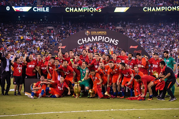 EAST RUTHERFORD, USA - JUNE 26: Players of Chile celebrate with the trophy after the championship match between Argentina and Chile at MetLife Stadium as part of Copa America Centenario 2016 on June 26, 2016, in East Rutherford, New Jersey, USA. (Photo by Stringer/Anadolu Agency/Getty Images)
