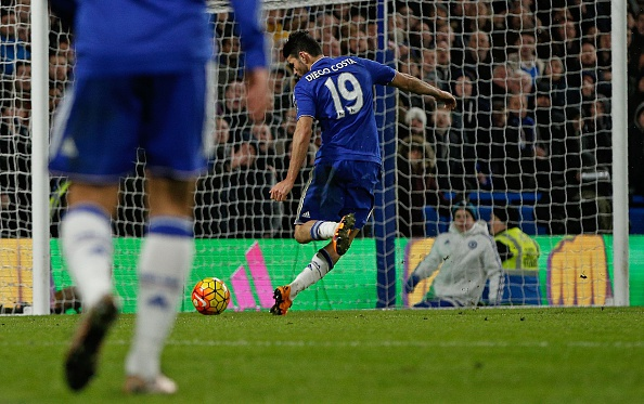 Chelsea's Brazilian-born Spanish striker Diego Costa shoots and scores during the English Premier League football match between Chelsea and Manchester United at Stamford Bridge in London on February 7, 2016. (Photo by ADRIAN DENNIS/AFP/Getty Images)