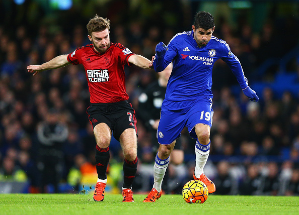 LONDON, ENGLAND - JANUARY 13: Diego Costa of Chelsea and James Morrison of West Bromwich Albion compete for the ball during the Barclays Premier League match between Chelsea and West Bromwich Albion at Stamford Bridge on January 13, 2016 in London, England. (Photo by Clive Mason/Getty Images)