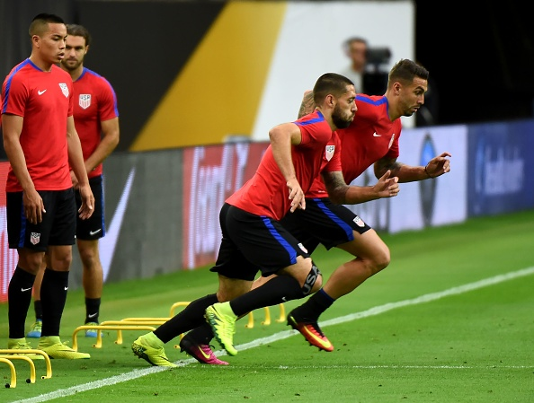 Dempsey and Cameron training ahead of their semi-final clash with Argentina. (Photo by MARK RALSTON/AFP/Getty Images)