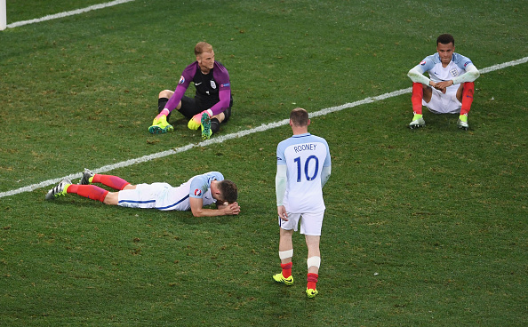 England players are distraught after their defeat against Iceland. (Photo by Laurence Griffiths/Getty Images)