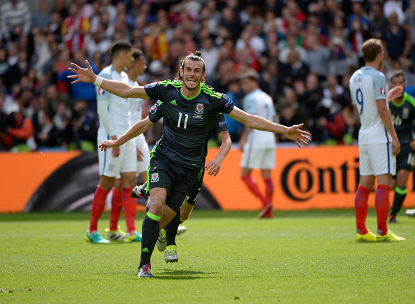 Gareth Bale celebrates after scoring from a free-kick against England. (Photo by Bob Thomas/Popperfoto/Getty Images).