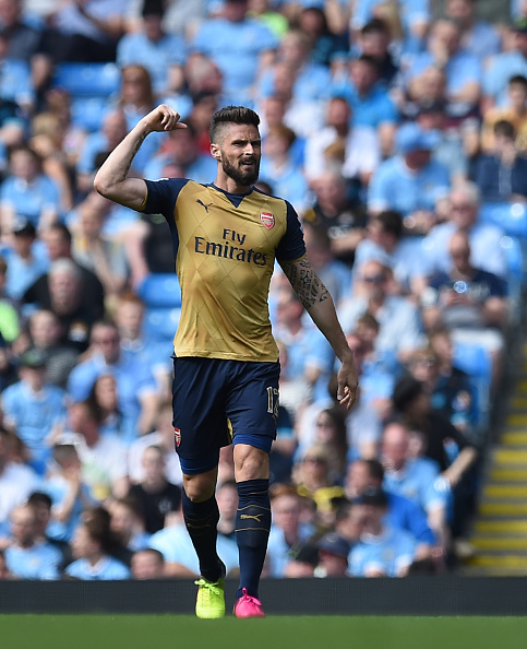 Arsenal's French striker Olivier Giroud celebrates after scoring during the English Premier League football match between Manchester City and Arsenal at the Etihad Stadium in Manchester, north west England, on May 8, 2016. (Photo via PAUL ELLIS/AFP/Getty Images)