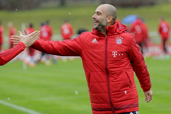 MUNICH, GERMANY - FEBRUARY 03: Josep Guardiola, Head Coach of FC Bayern Muenchen shakes hands with a player during a FC Bayern Muenchen training session at the club's training ground on February 3, 2016 in Munich, Germany. (Photo by Adam Pretty/Bongarts/Getty Images)