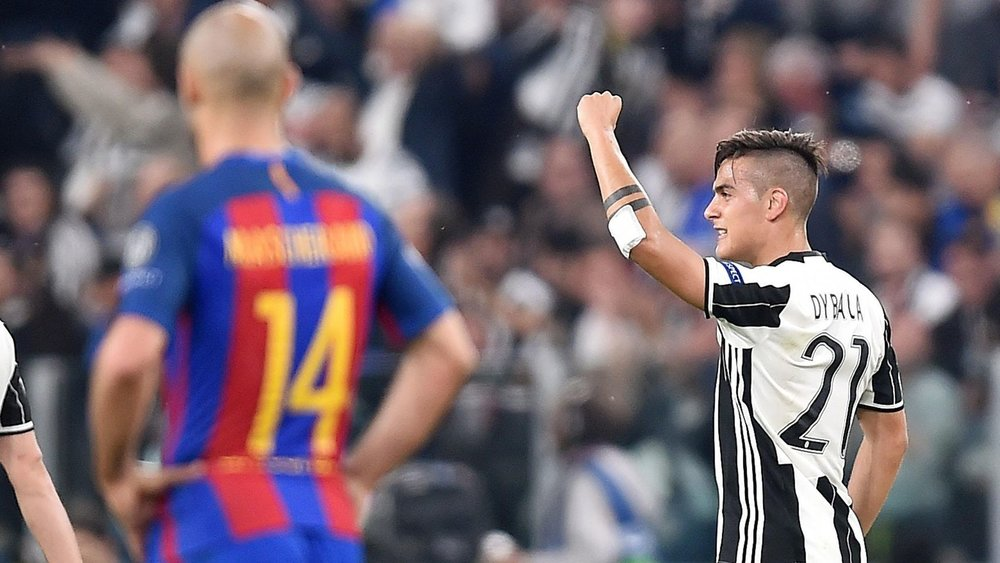 Dybala celebrates after scoring against Barcelona. (Photo via Getty Images)