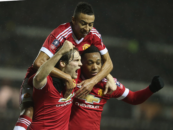 DERBY, ENGLAND - JANUARY 29: Daley Blind of Manchester United celebrates scoring their second goal during the Emirates FA Cup Fourth Round match between Derby County and Manchester United. (Photo by Matthew Peters/Man Utd via Getty Images)