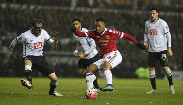 DERBY, ENGLAND - JANUARY 29: Anthony Martial of Manchester United in action with Richard Keogh of Derby County during the Emirates FA Cup Fourth Round match between Derby County and Manchester United. (Photo by Matthew Peters/Man Utd via Getty Images)
