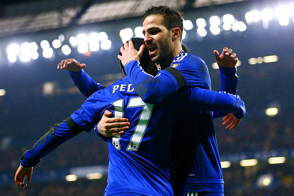 LONDON, ENGLAND - FEBRUARY 13: Pedro (L) of Chelsea celebrates scoring his team's second goal with his team mate Sesc Fabregas (R) during the Barclays Premier League match between Chelsea and Newcastle United at Stamford Bridge on February 13, 2016 in London, England. (Photo by Clive Mason/Getty Images)