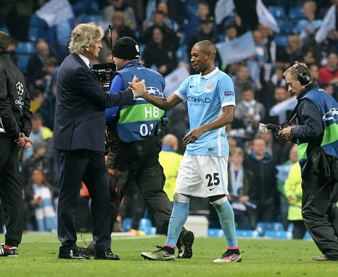 MANCHESTER, ENGLAND - APRIL 12: Fernandinho of Manchester City react with Manuel Pellegrini after the victory during the UEFA Champions League Quarter Final second leg match between Manchester City FC and Paris Saint-Germain at the Etihad Stadium on April 12, 2016 in Manchester, United Kingdom. (Photo by Xavier Laine/Getty Images )