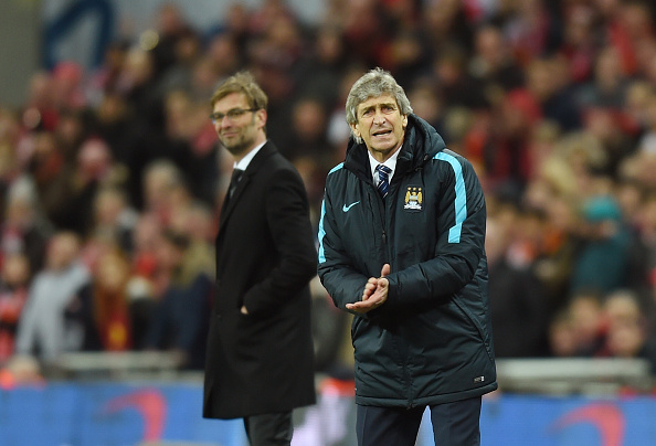Manuel Pellegrini encourages his team during the Capital One Cup final against Liverpool. (Photo by Michael Regan - The FA/The FA via Getty Images)