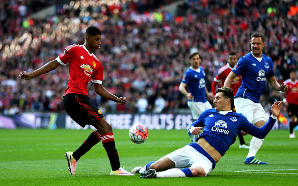 LONDON, ENGLAND - APRIL 23: Marcus Rashford of Manchester United is tackled by John Stones of Everton during the Emirates FA Cup Semi Final match between Everton and Manchester United at Wembley Stadium on April 23, 2016 in London, England. (Photo by Alex Morton - The FA/The FA via Getty Images)