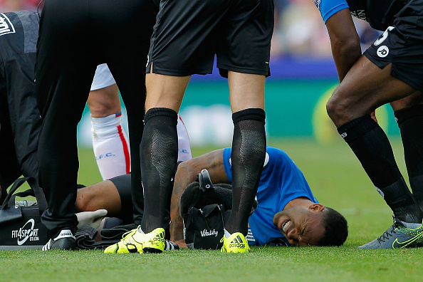 STOKE ON TRENT, ENGLAND - SEPTEMBER 26: Callum Wilson of Bournemouth lies on the ground after his injury during the Barclays Premier League match between Stoke City and A.F.C. Bournemouth at Britannia Stadium. (Photo by Malcolm Couzens/Getty Images)